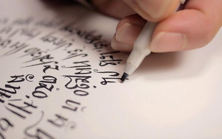 A language creator writes their own language.