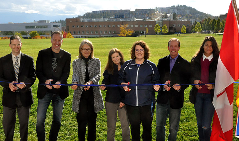 Stephen Fuhr, Member of Parliament for Kelowna-Lake Country (second from left) and UBC Okanagan Deputy Vice-Chancellor and Principal Deborah Buszard (third from left) stand with UBC staff and students at the opening of the Commons Field Wednesday.