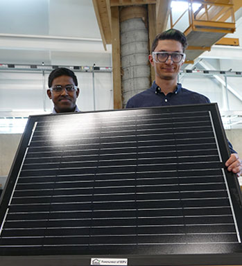 Engineering graduate students Tharaka Wanniarachchi and Remy Kennedy-Kuiper are working on a system to keep solar panels clear of ice and snow so they work effectively during winter months.