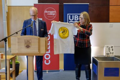 Okanagan College President Jim Hamilton and UBC Okanagan's Deputy Vice-Chancellor Deborah Buszard remove items from Okanagan University College 25 year time capsule