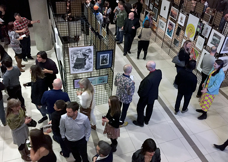 Participants at last year's Art on the Line browse the large selection of art work before the auction begins.