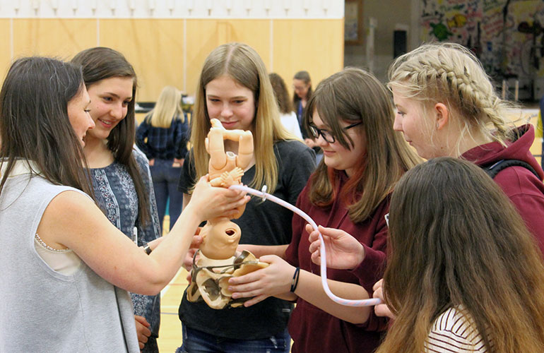 Students at Revelstoke Secondary School learn about the field of midwifery during the 2018 roadshow.