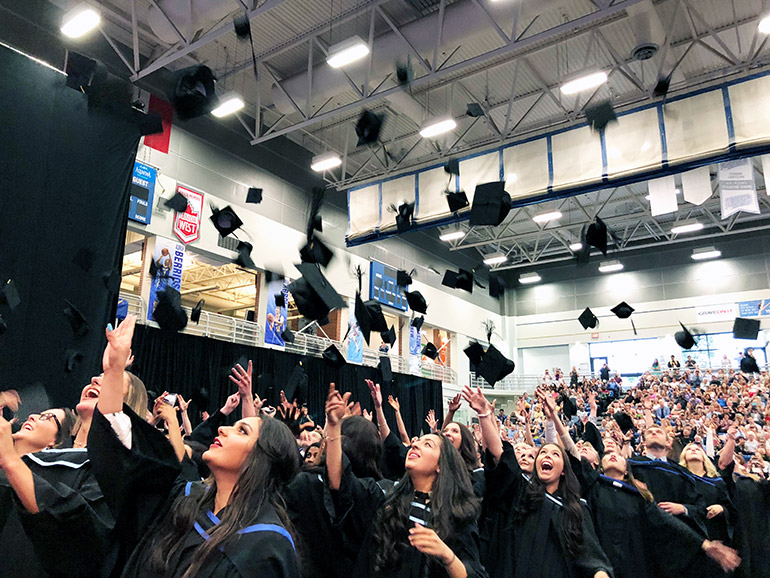New graduates celebrate their success after their convocation ceremony at UBCO last June.