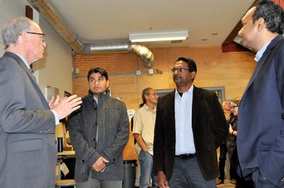 Okanagan College President Jim Hamilton, left, with UBC engineers Rehan Sadiq, Kasun Hewage and Shahria Alam discusses green technology educational opportunities during a tour of the college's Jim Pattison Centre of Excellence.