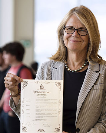 Deborah Buszard, UBC Deputy Vice-Chancellor and Principal of UBC Okanagan, with the official proclamation by Kelowna Mayor Colin Basran, establishing Saturday, September 28, as UBCO Homecoming Day in Kelowna.