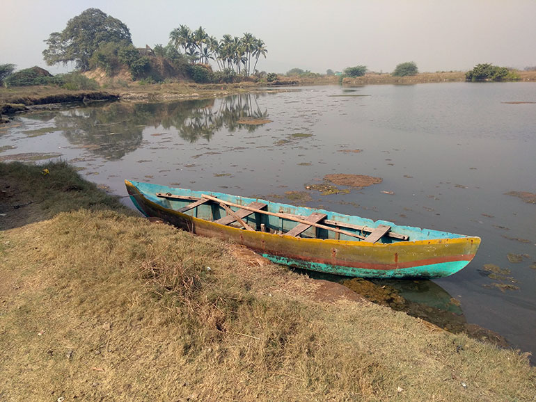An abandoned boat in a swamp near Mumbai symbolizes how environmental histories, including colonialism resource extraction, may become irrelevant as climate change takes centre stage in global concerns.
