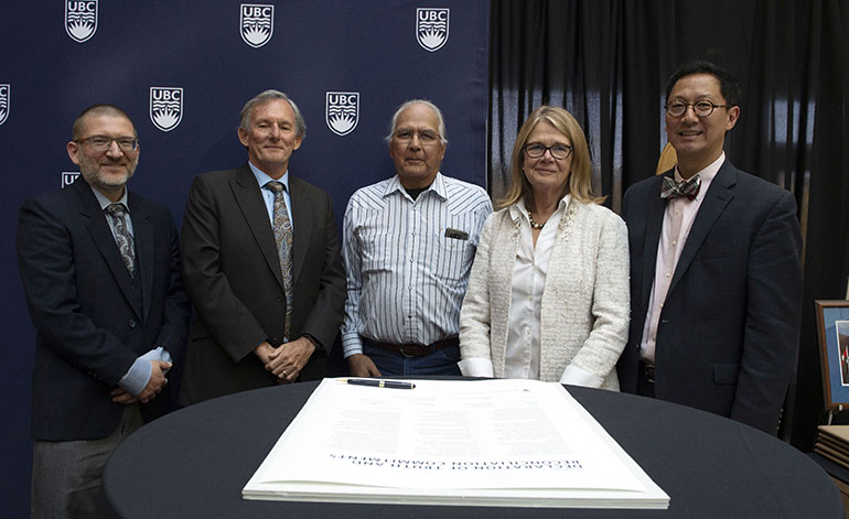 Signing the declaration of commitments were, from left, Ian Foulds, Aboriginal Advisory Committee co-chair, Ian Cull, Aboriginal Advisory Committee chair, Eric Mitchell, Cultural Safety Educator and adjunct professor in the Faculty of Creative and Critical Studies, Deborah Buszard, UBC Deputy Vice-Chancellor and Principal, and Santa Ono, UBC President and Vice-Chancellor.