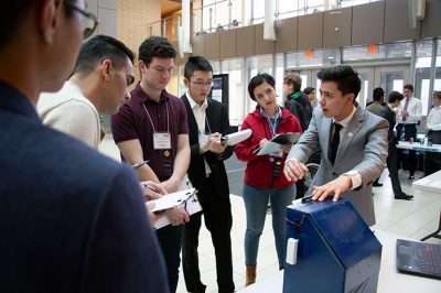 A student pitches his donation bin redesign to judges at last year's competition.