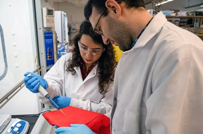 UBC Okanagan researchers Sadaf Shabanian (left) and Kevin Golovin (right) test water-repellent fabric treatment.
