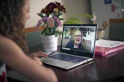 Naomi Mison, who is hosting an event to discuss virtual solutions to support loved ones during COVIID-19, has a conversation with her mother on Skype.