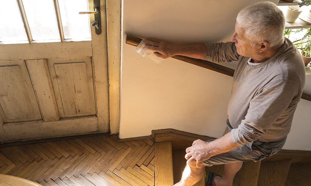 A man using a handrail for balance