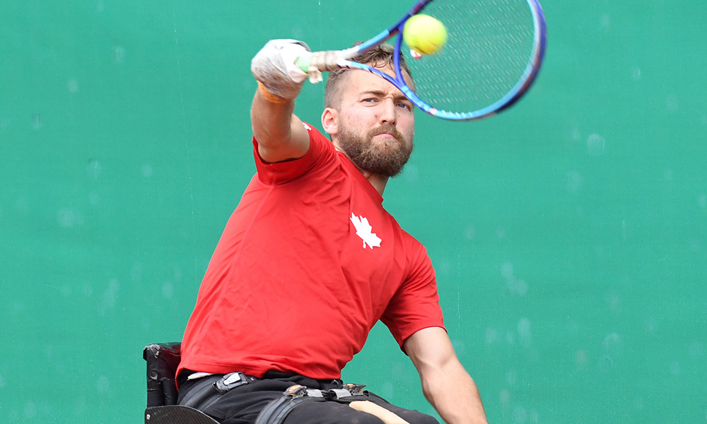 Dr. Rob Shaw plays singles wheelchair tennis