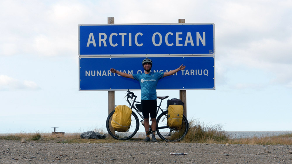 Michael Friedland in front of an Arctic Ocean sign