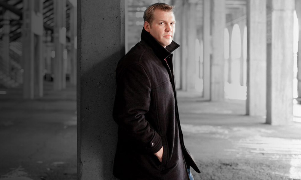 A picture of Dr. Chris Nowinski in an industrial setting