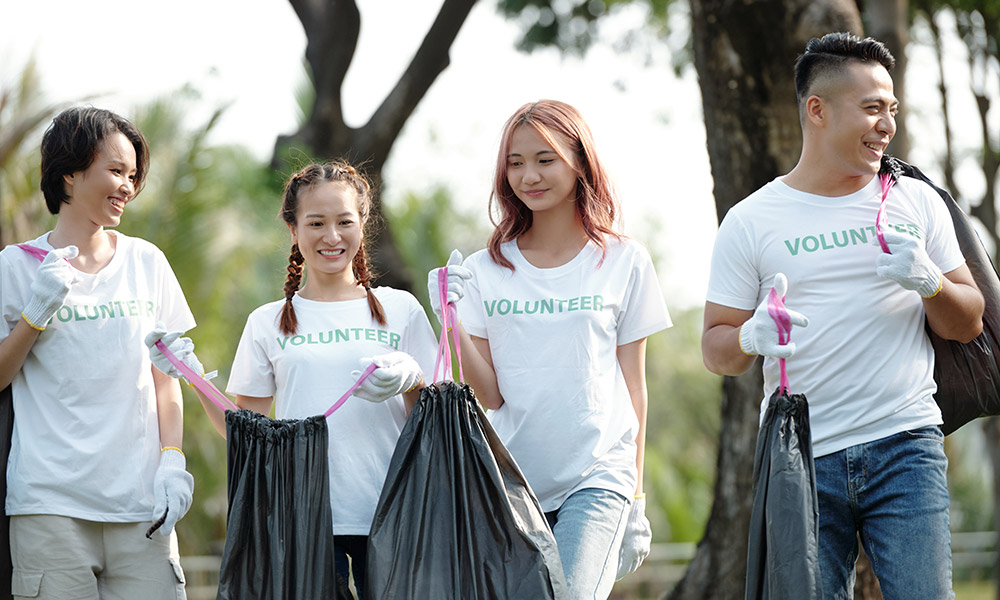 A group of student volunteers picking up trash