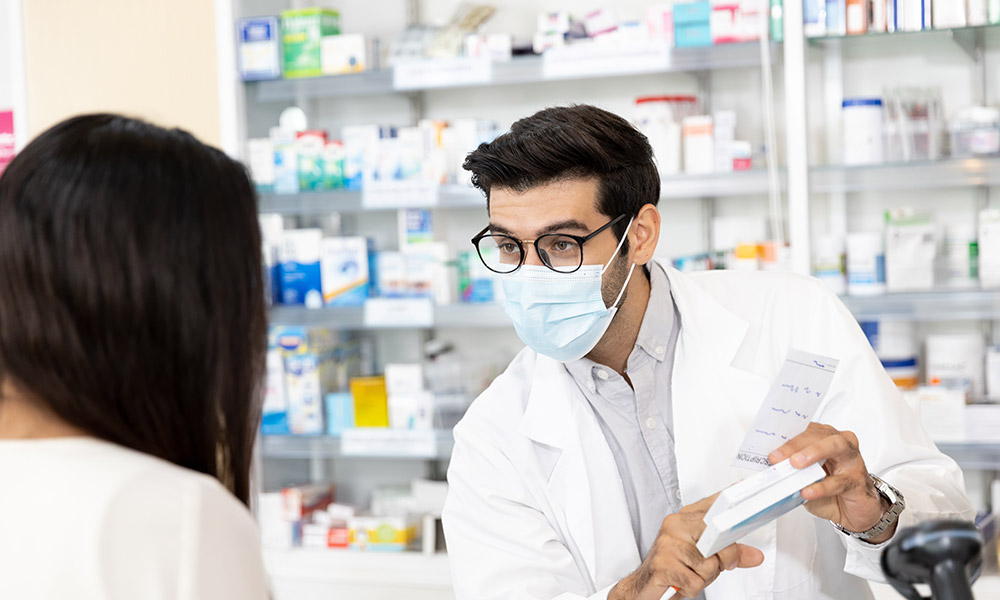 A pharmacist giving advice to a patient