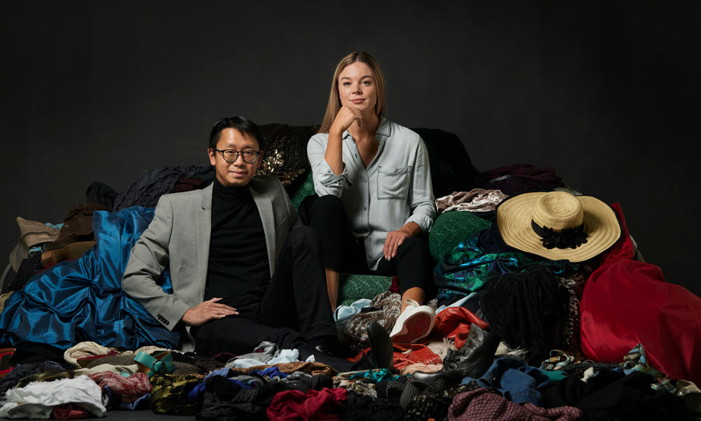Ariele and Eric sitting in a pile of clothes